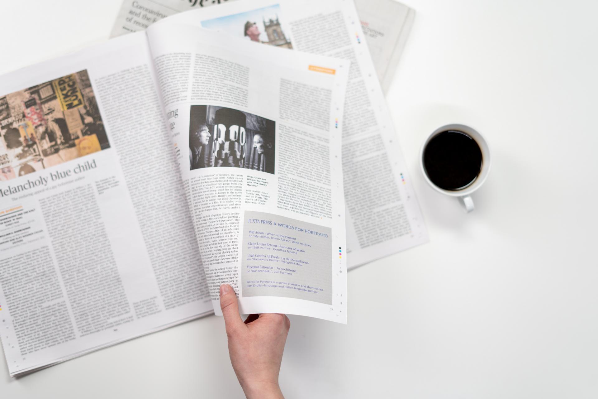 Person leafs through a magazine