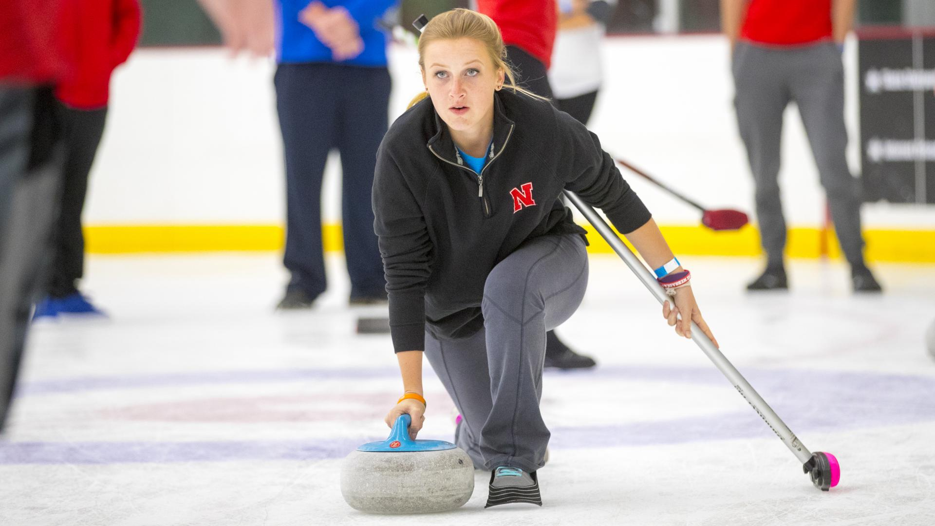 A member of the Nebraska Curling Club practices at the Breslow Ice Center.