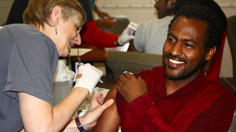 An international student receives a flu shot from the University Health Center at the University of Nebraska-Lincoln
